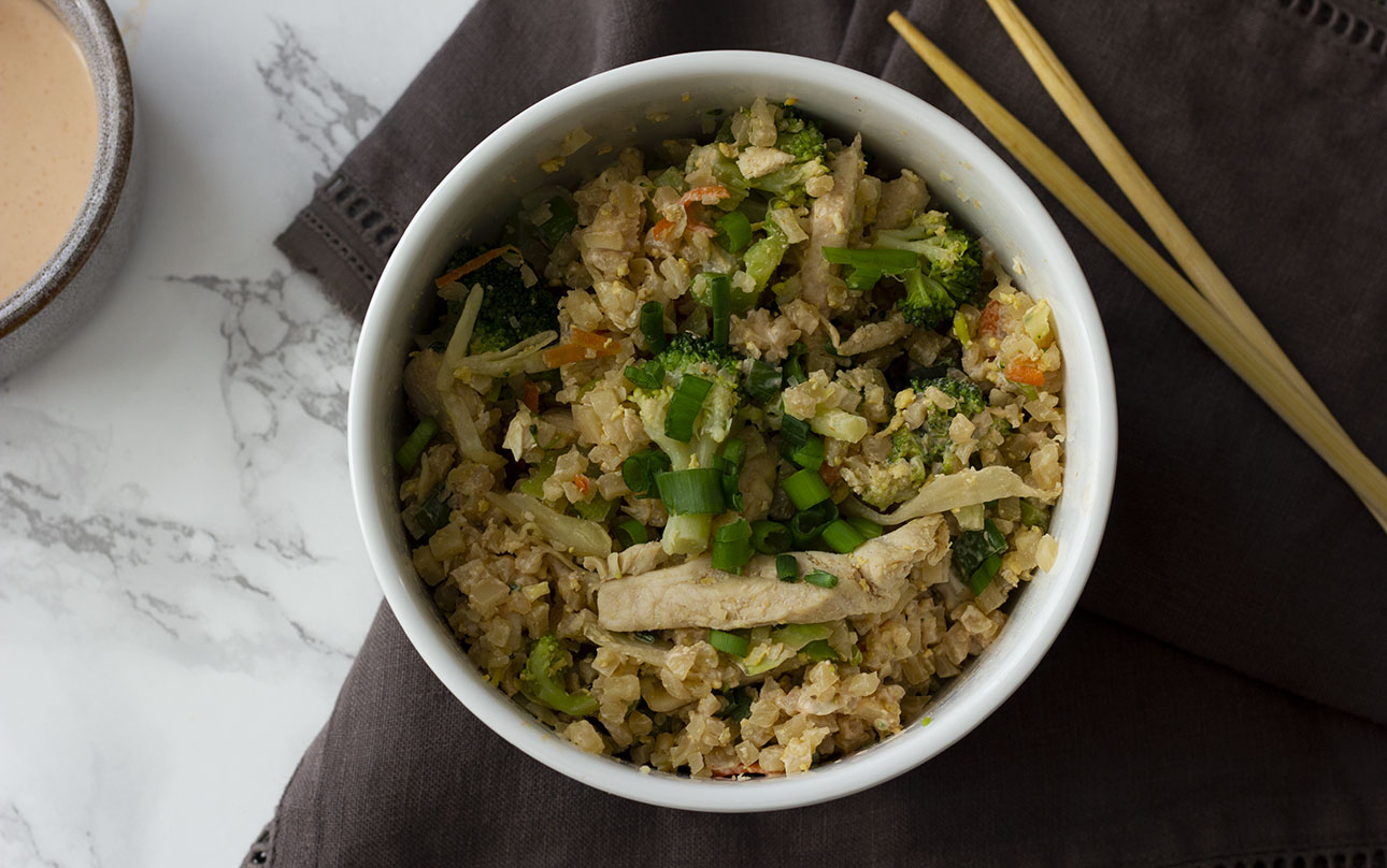 Skip the take out and make keto fried cauliflower rice at home. Simple ingredients, fast to whip up, and ultra low carb. Keto fried rice is gluten free, Paleo, and Whole30 approved.