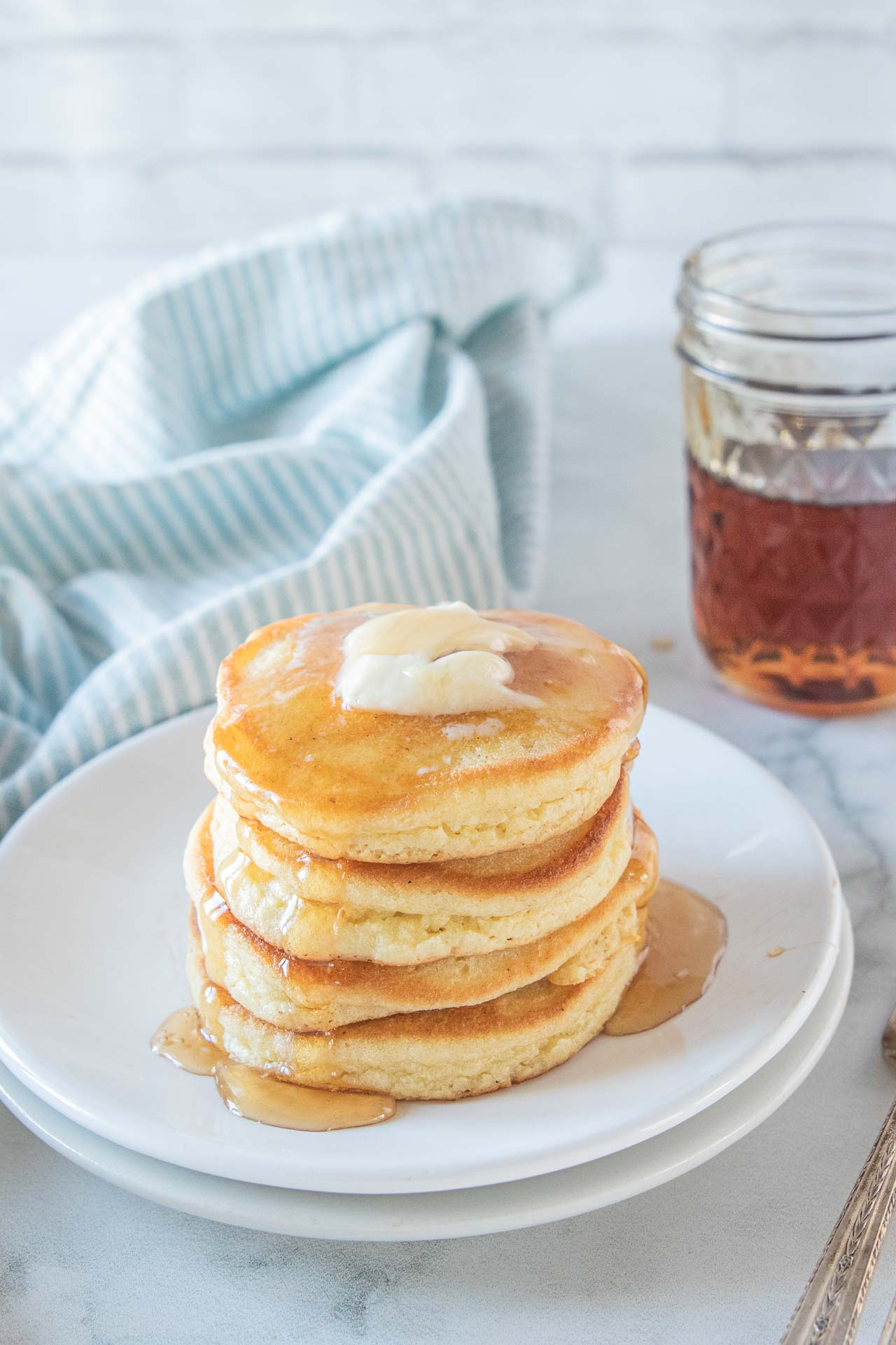 Tall stack of fluffy keto pancakes.