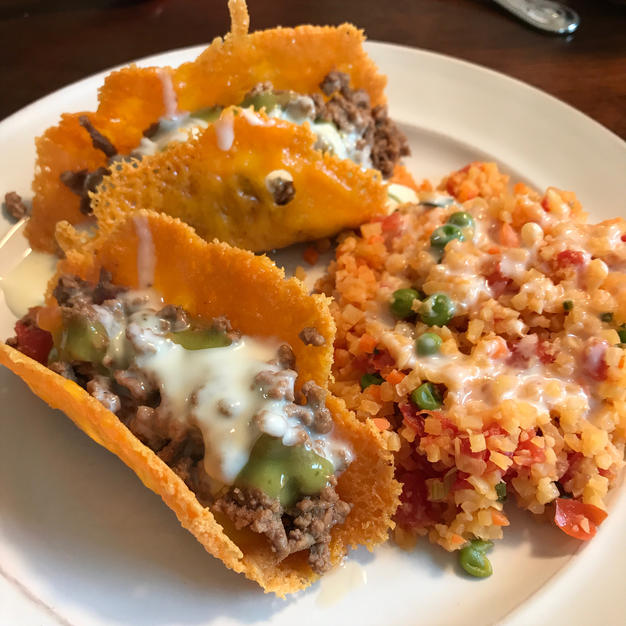 Restaurant style keto Mexican rice. Cauliflower rice and mexican seasonings transfrom plain cauli rice into a savory side for tacos, enchiladas, or bowls.