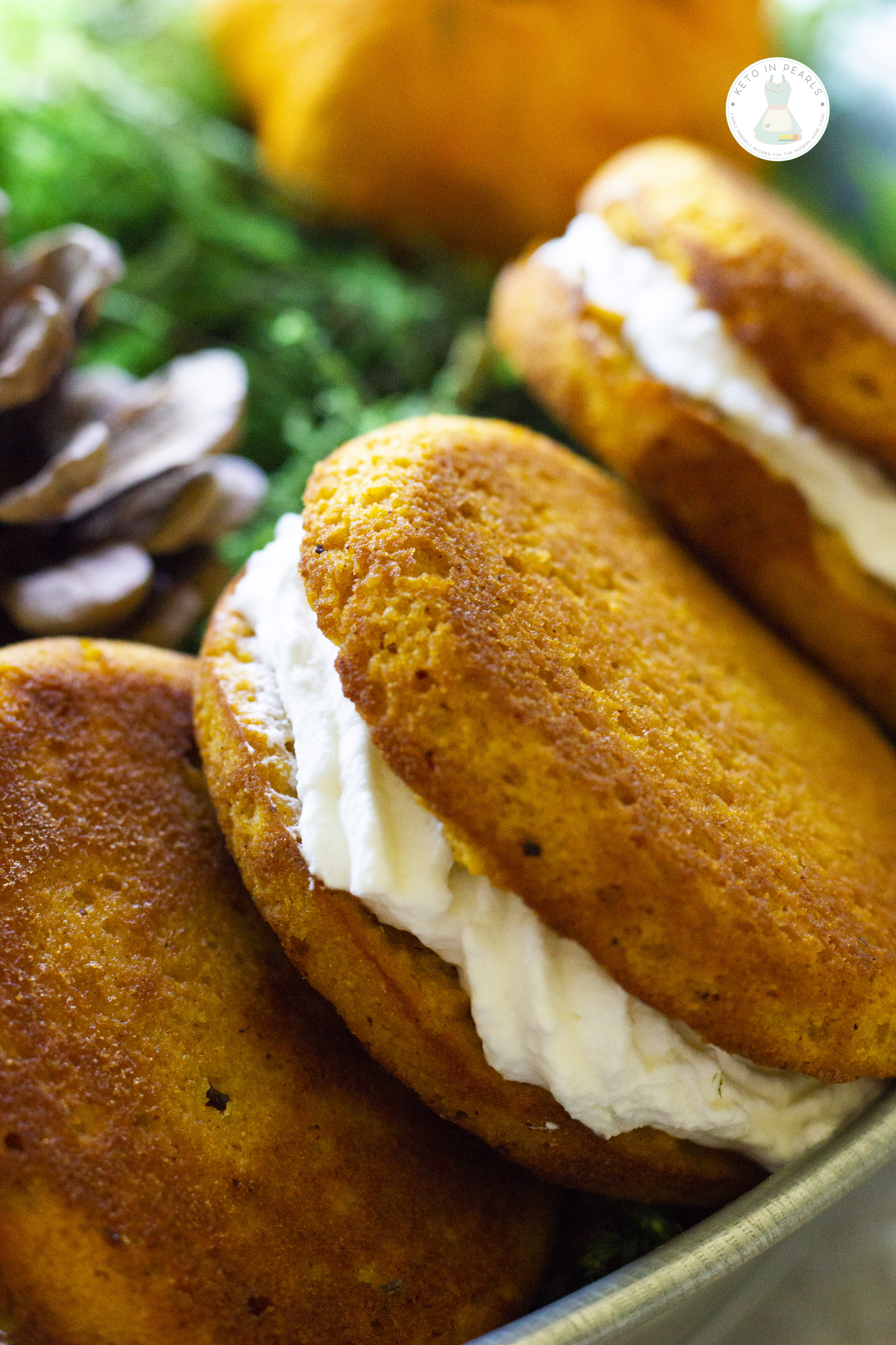A keto pumpkin roll in handheld form! These keto pumpkin spice whoopee pies are low in carbs, easy to bake, and perfect for carrying to the pumpkin patch!