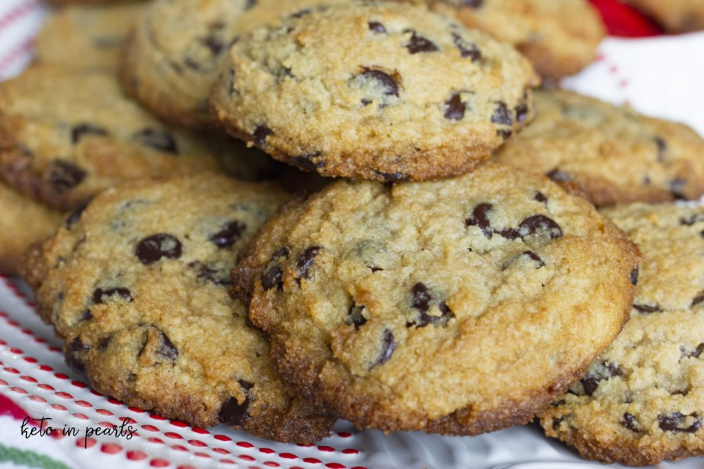 Soft and chewy keto chocolate chip cookies that are gluten free, grain free, sugar free, and only 2 net carbs per cookie!