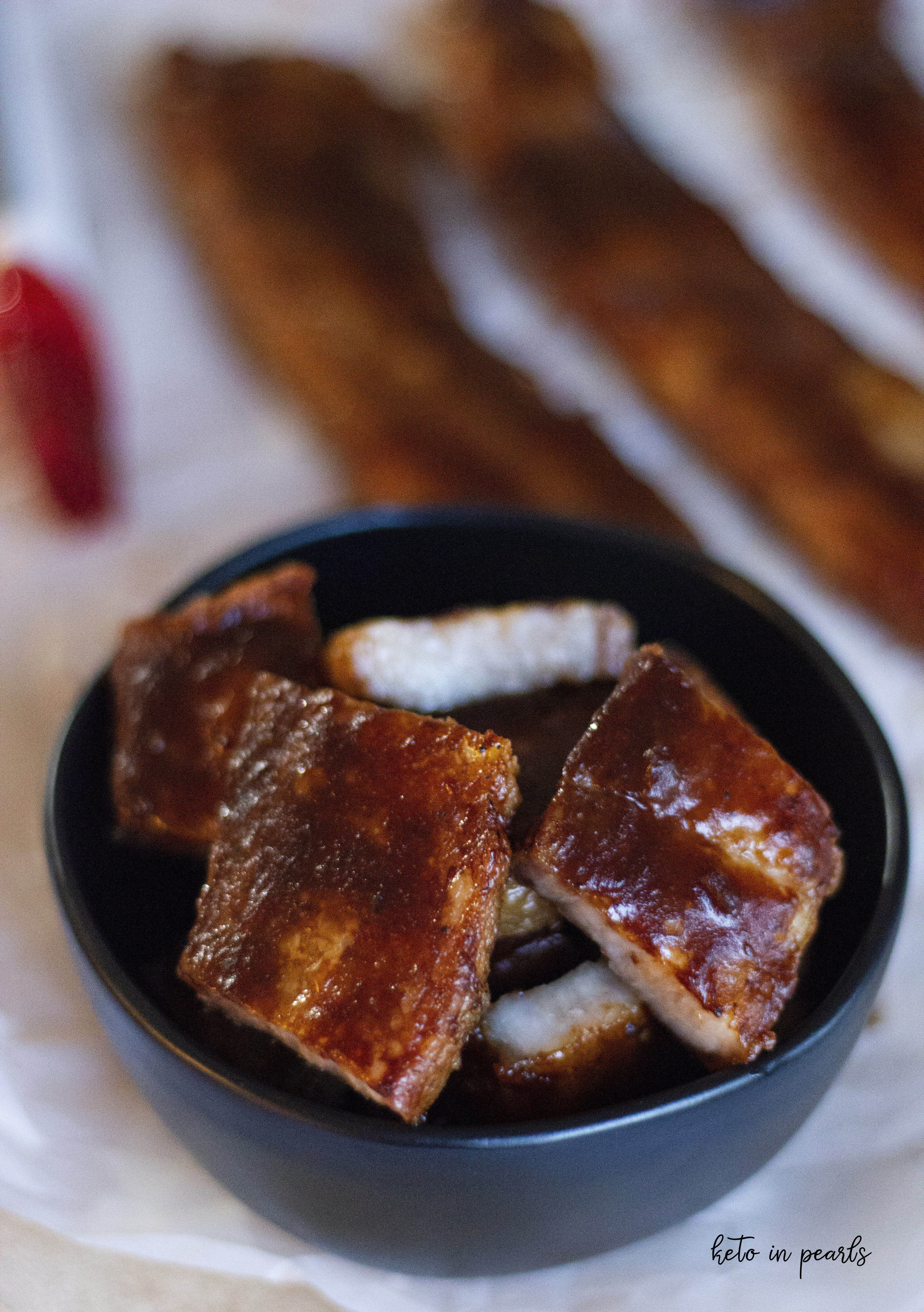 Thick pieces of BBQ pork belly are baked until crispy and slathered with a smokey hot BBQ sauce. Only 1 carb per bite!