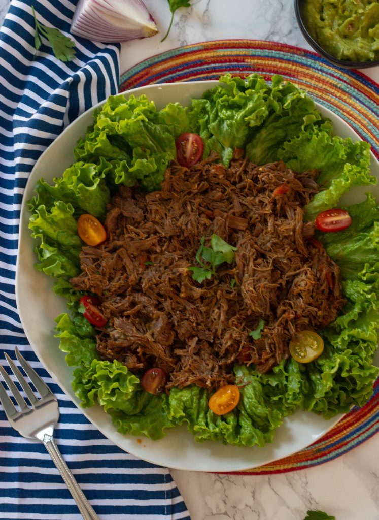 A keto Mexican pot roast for use in tacos, salads, or all on its own. Taste just like a keto Chipotle barbacoa. Instant Pot and slow cooker options.
