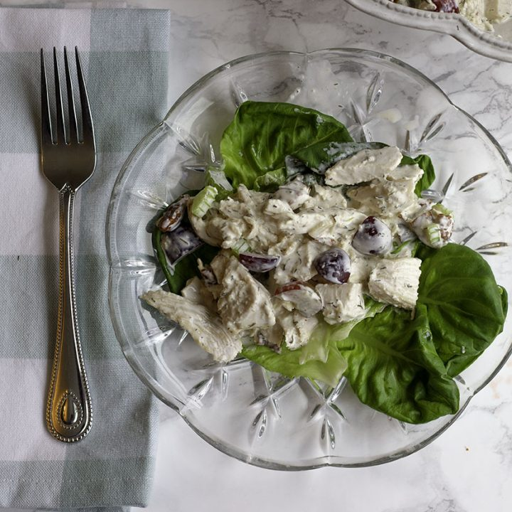 Homemade keto chicken salad with pecans, dill, and even grapes! This chicken salad is bursting with flavor and only 2 net carbs per serving. It's even Paleo and Whole 30 friendly.