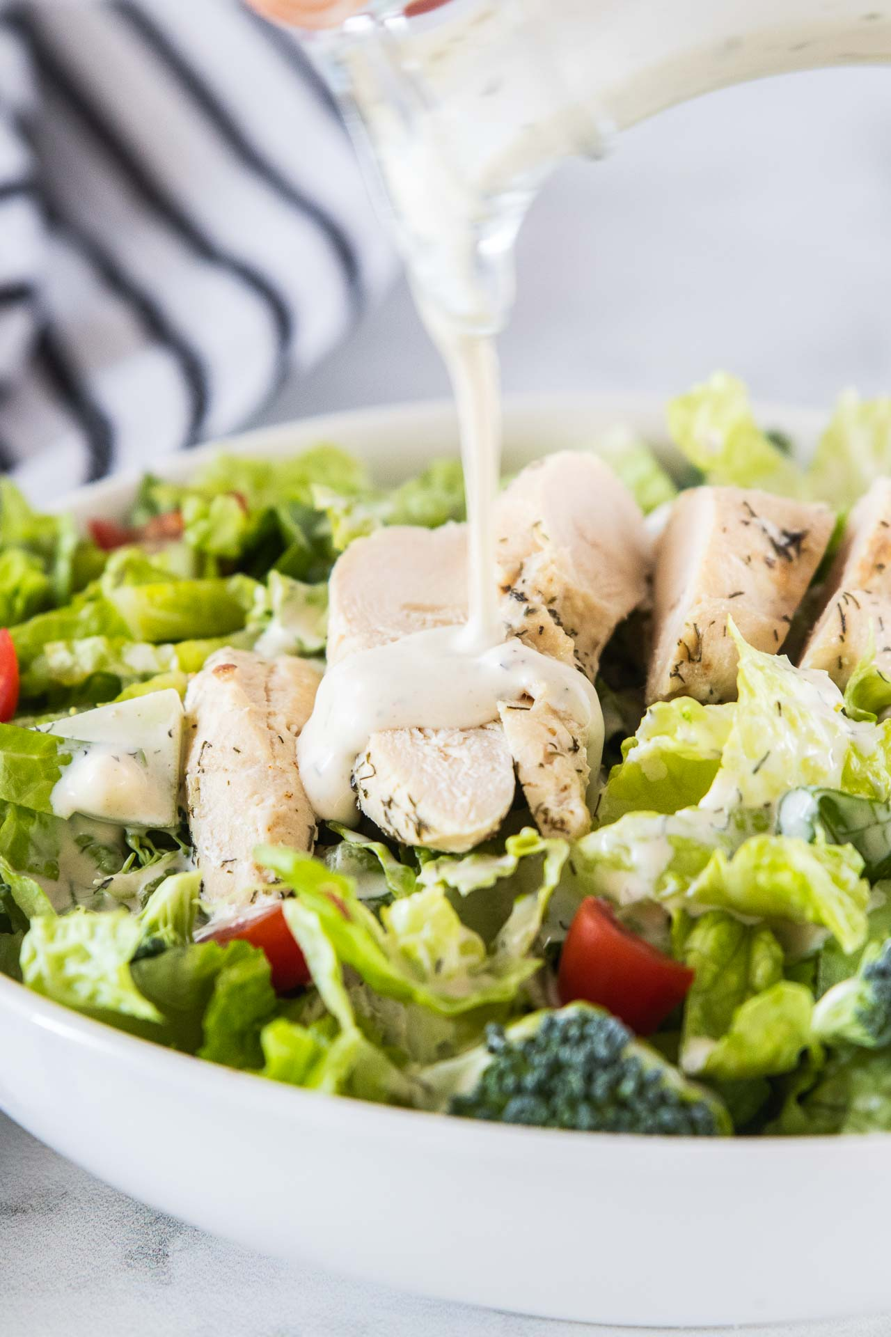 Keto ranch dressing drizzled on a salad.