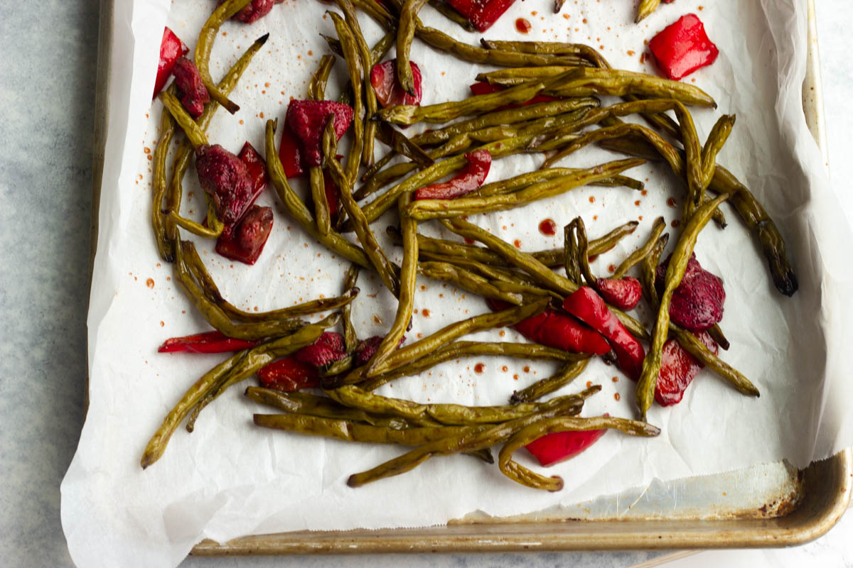 Crisp green beans are roasted with sweet strawberries in a balsamic glaze. A low carb and low calorie side dish for the summer!