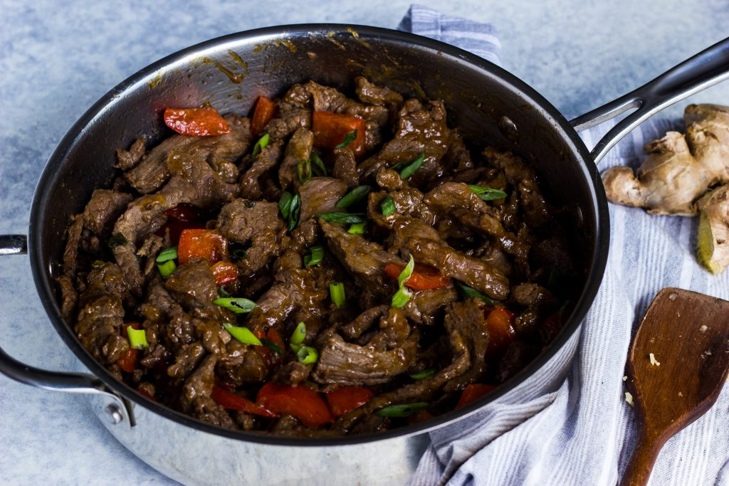 Keto beef stir fry with peppers in an orange ginger sauce