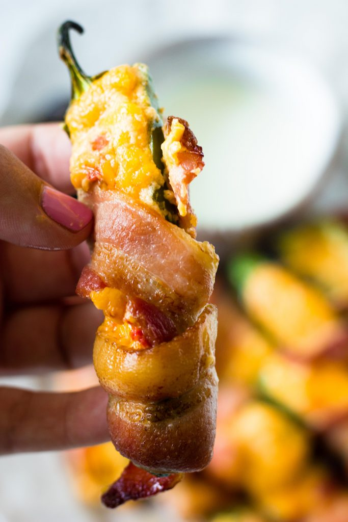 These keto jalapeño poppers are not your average keto snack. Pimento cheese steals the show in this 3 ingredient keto jalapeno popper recipe.