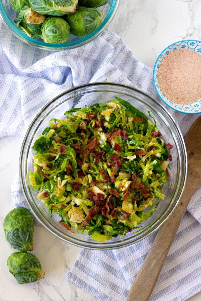 Keto brussel sprout salad with bacon. 3.5 net carbs per serving. A dairy free keto recipe with no oven required.