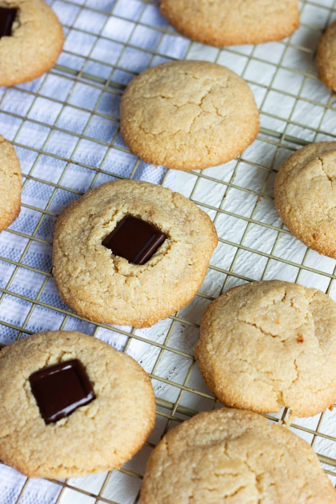 These soft and chewy homemade sugar free peanut butter cookies are little bites of nostalgia. Only 1 net carb and 105 calories per cookie too! Add some of your favorite sugar free chocolate candy to the middle for a sugar free and keto peanut butter blossom!