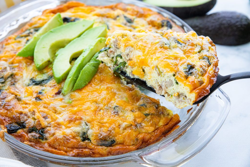 Savory and satisfying, this easy low carb crustless quiche with sausage and spinach is a treat any time of day. Whether it's breakfast, brunch, or dinner, you're going to love this crustless twist on a French classic.