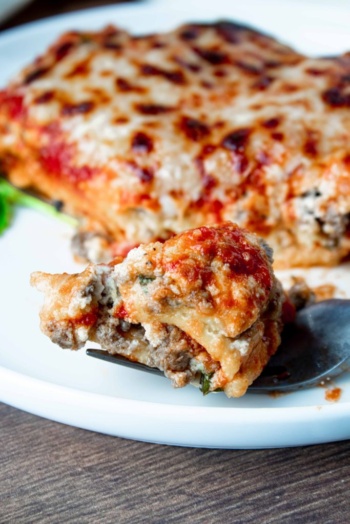 A cheesy, layered, classic keto lasagna with meat sauce and real noodles! This low carb lasagna is hearty and robust and just like a real lasagna should be.