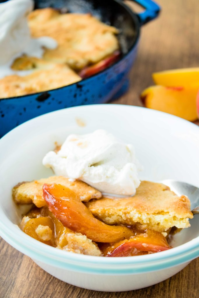 A rustic Southern inspired low carb peach cobbler that is free of added sugar, gluten, and can also be dairy free! Enjoy peaches on your low carb diet with this easy low carb peach cobbler.
