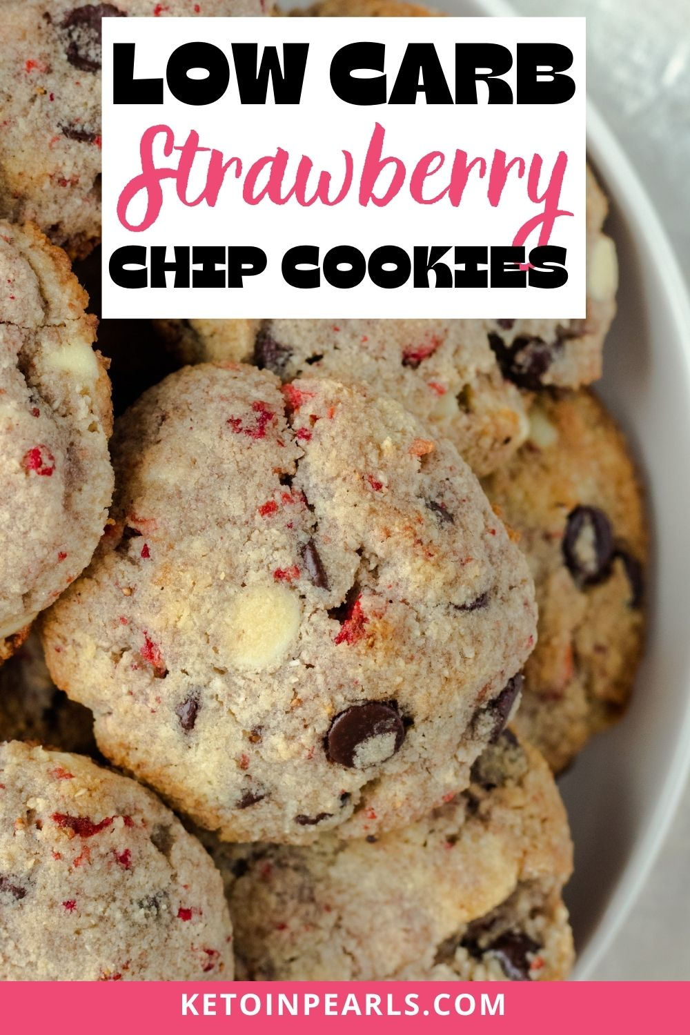 Sugar free dark chocolate, white chocolate, and bits of strawberries make these low carb chocolate chip cookies extra yummy! This keto cookie recipe can be made in one bowl too. Only 2.3 net carbs per cookie.