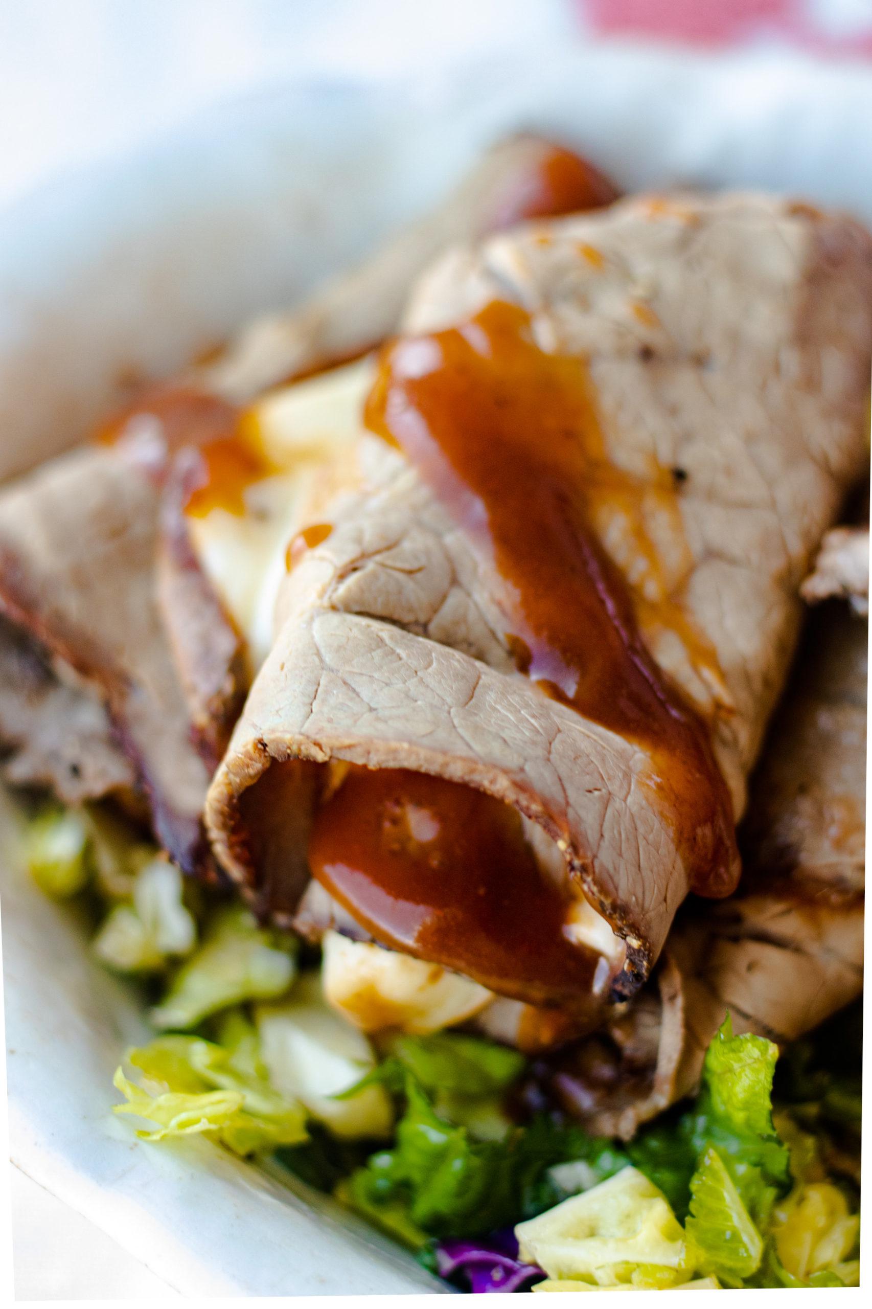 Close up of gooey roast beef keto wrap.