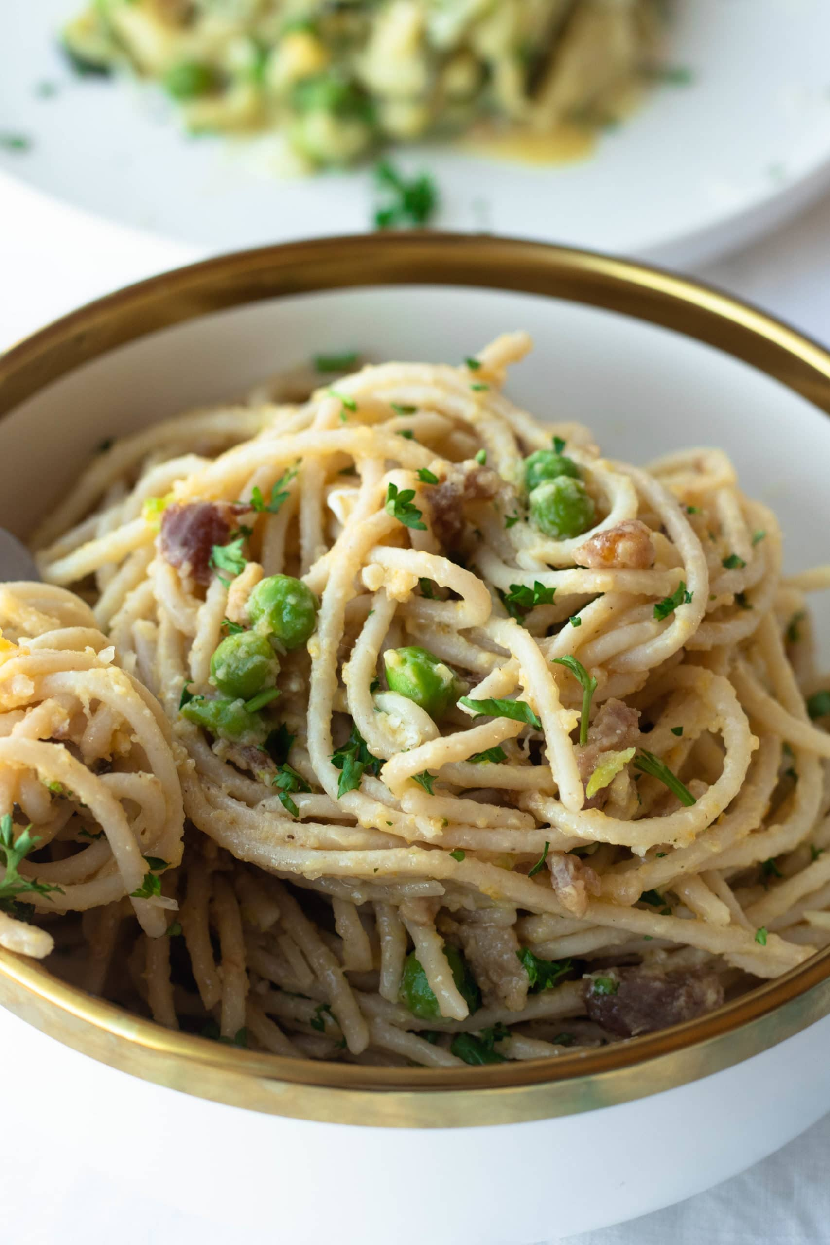 Classic carbonara pasta is transformed into a healthy, gluten free, and low carb pasta recipe. Parmesan cheese, peas, bacon, and browned butter adorn your choice of low carb noodles or zucchini noodles. This decadent keto carbonara will make you forget you're eating healthy!