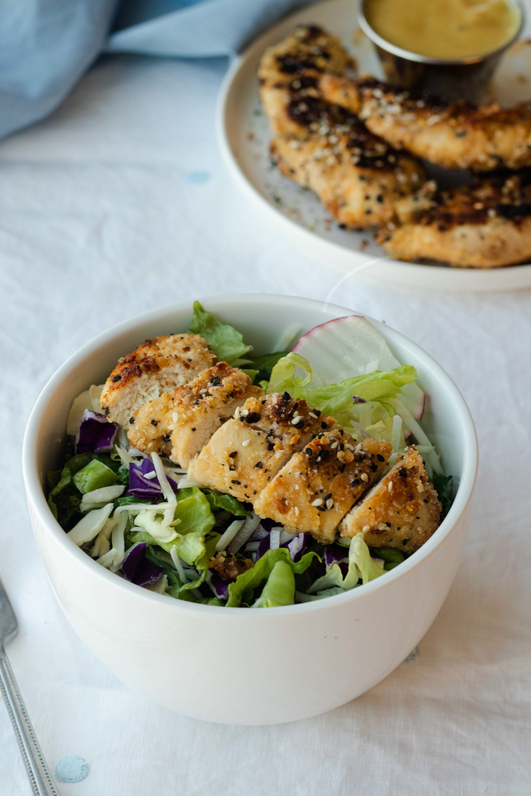 These savory keto chicken strips are breading an almond flour coating that is seasoned well with everything bagel seasoning. Great on salads and wraps!