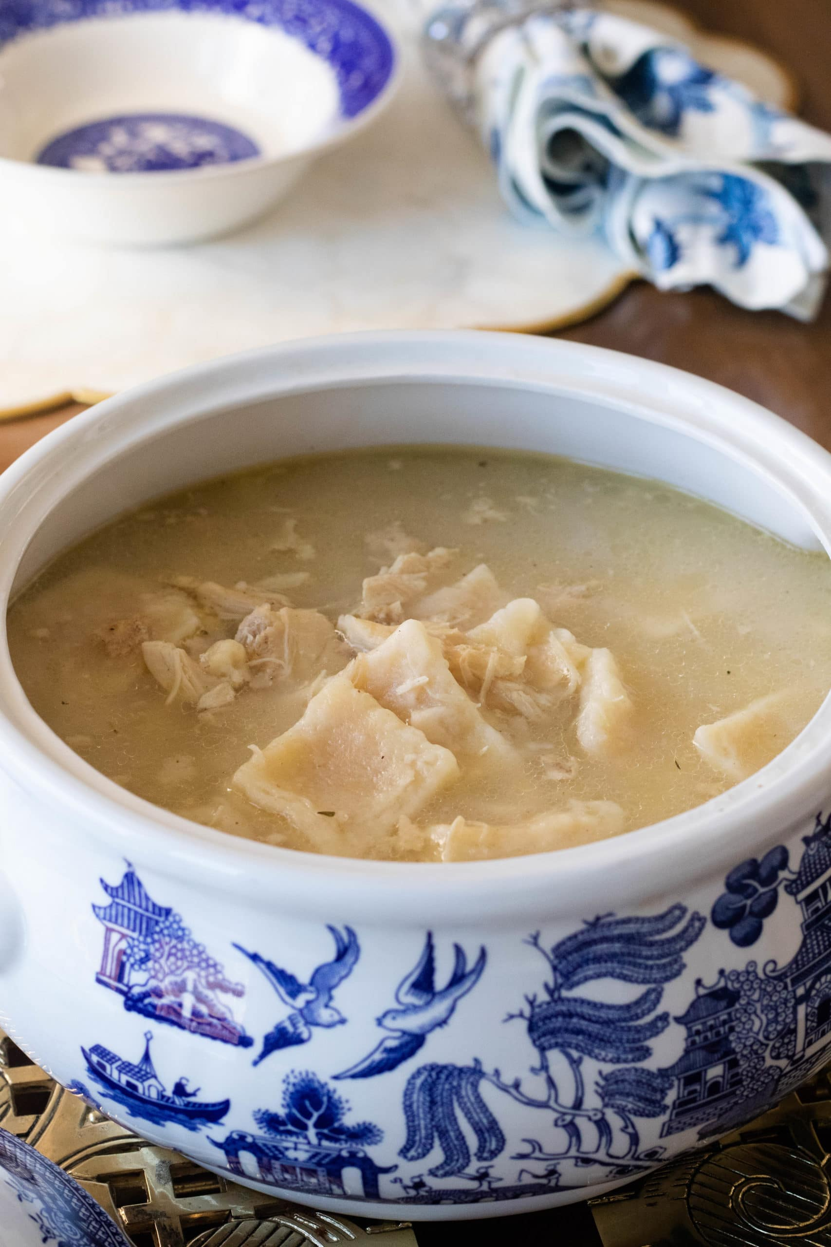 Pillowy soft dough dumplings and tender chicken are covered in a savory and thick broth.