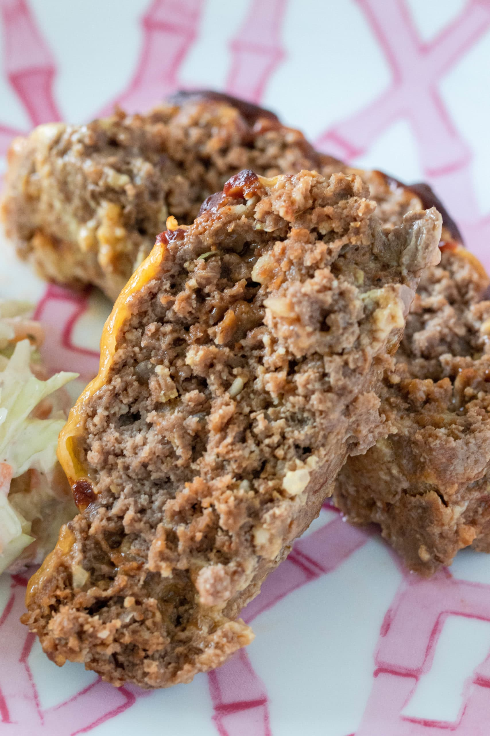 BBQ cheddar meatloaf made without breadcrumbs. This gluten free meatloaf is free of grains, oatmeal, and rice. Also a clean keto meatloaf recipe.