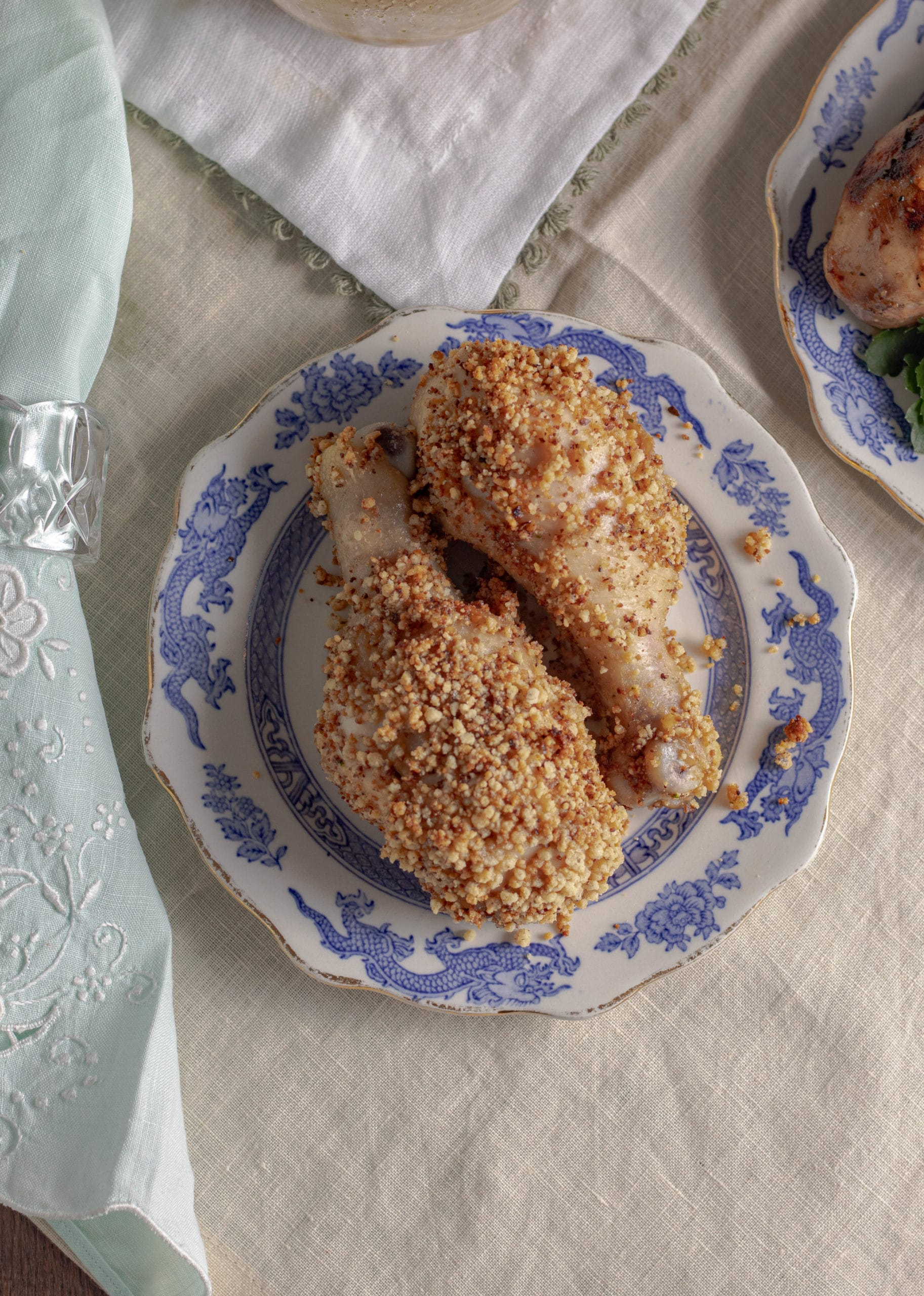 Crispy baked chicken drumsticks are marinated chicken legs are coated in a homemade gluten free breading. Keto shake and bake chicken copycat recipe.