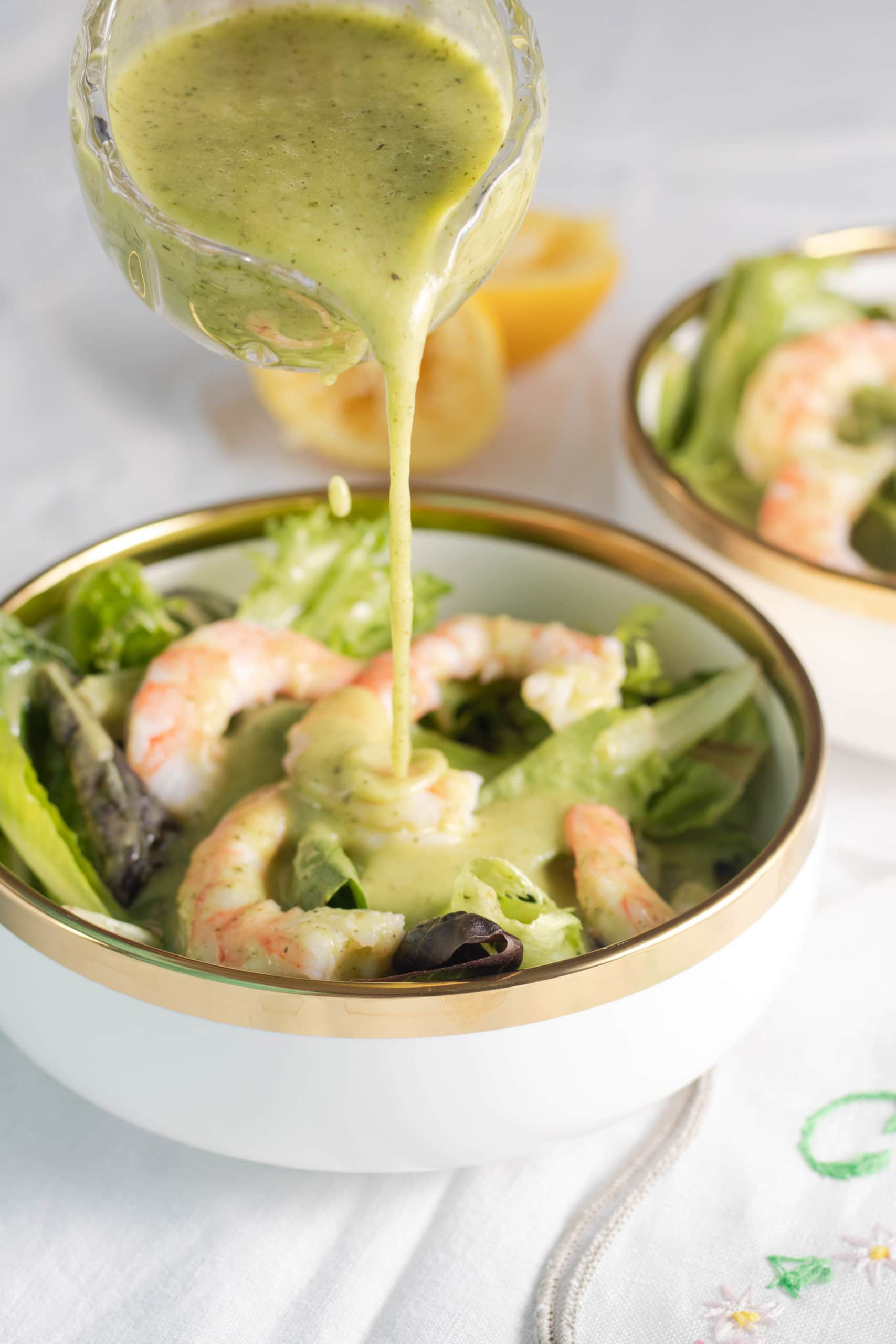 Low carb salad dressing on a salad with shrimp.